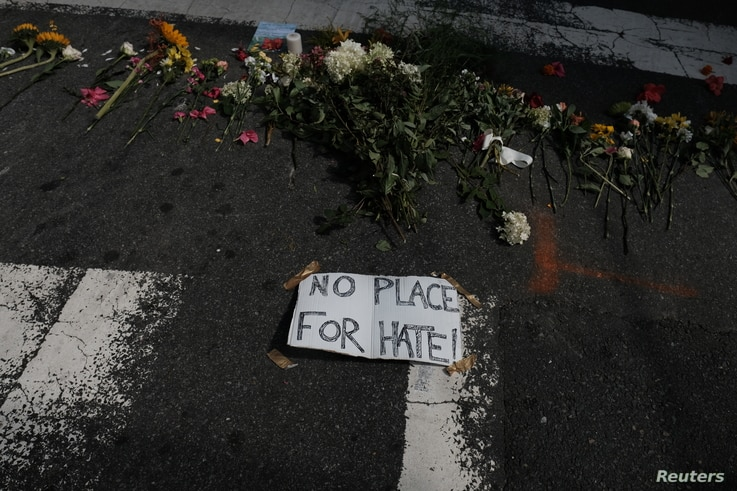 Flowers lie at a makeshift memorial at the scene of where a car plowed into counter-protesters in Charlottesville, Virginia, Aug. 13, 2017.