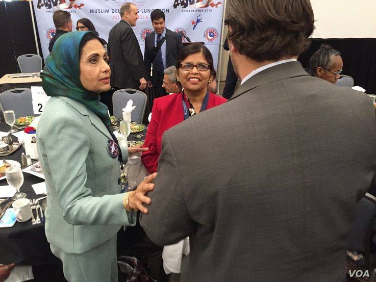 Sarwat Husain (left, in green jacket) at the AMDC Luncheon at the Pennsylvania Convention Center during the Democratic National Convention.