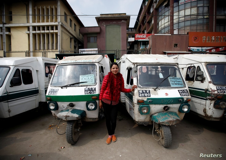 Januka Shrestha, 25, a Tuk Tuk driver, poses for a picture in Kathmandu, Nepal, Feb. 26, 2017.