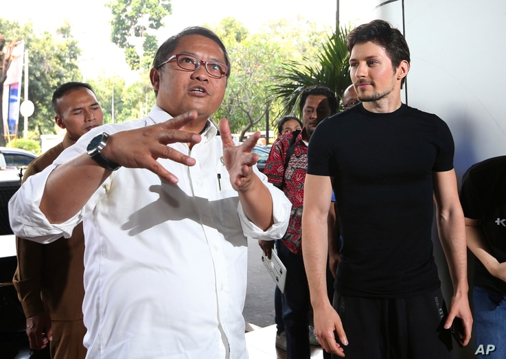 Indonesian Communication and Information Minister Rudiantara, left, accompanied by Telegram co-founder Pavel Durov, right, speaks as they meet in Jakarta, Aug. 1, 2017.