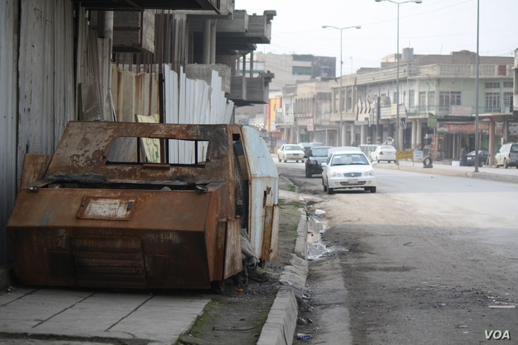 On streets of Iraqi-controlled eastern Mosul, evidence of the war is omnipresent, like this armored car bomb on Feb. 12, 2017. (H.Murdock/VOA)