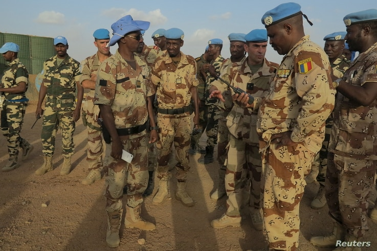 FILE - French and Chadian peacekeepers talk at the Minusma peacekeeping base in Kidal, Mali.