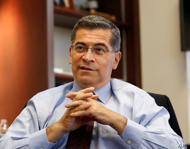 California Attorney General Xavier Becerra discusses various issues during an interview with The Associated Press, in Sacramento, California, Oct. 10, 2018.
