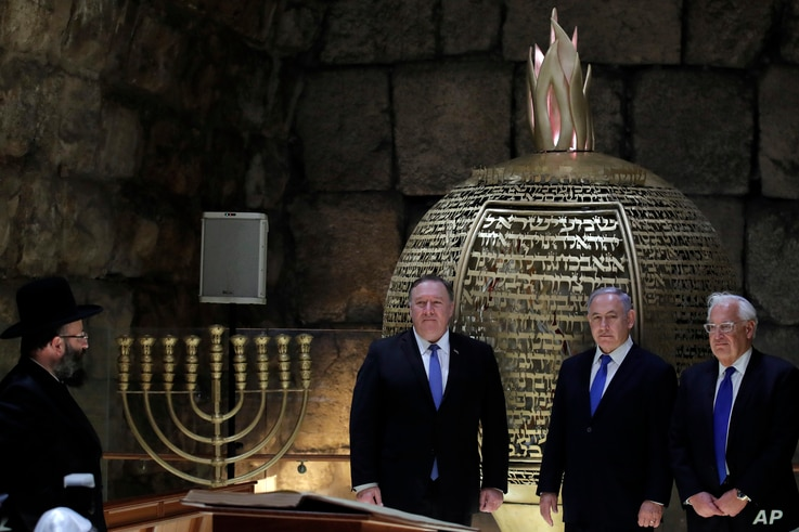 Israeli Prime Minister Benjamin Netanyahu, center, U.S. Secretary of State Mike Pompeo, left, and U.S. Ambassador to Israel David Friedman visit the Western Wall Tunnels in Jerusalem's Old City, March 21, 2019.