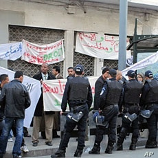 Riot police blocking a teachers strike for better benefits in Algiers
