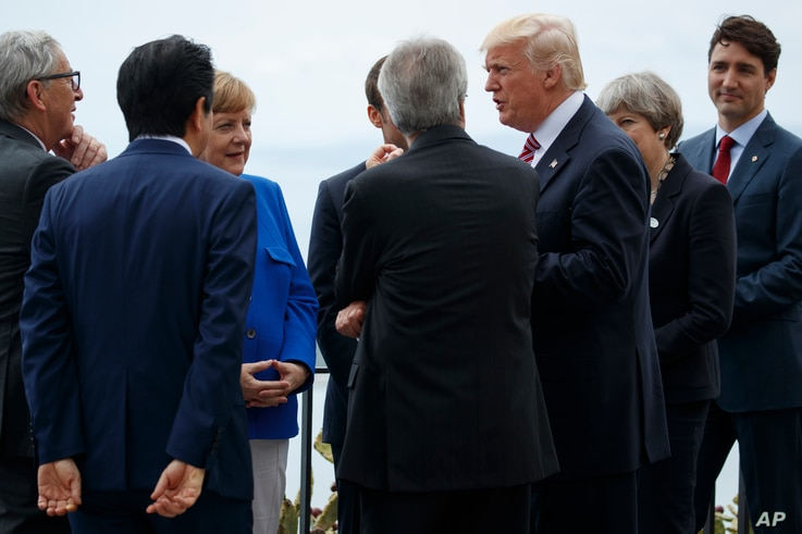 President Donald Trump poses for photos with G7 leaders at the Ancient Greek Theater of Taormina during the G7 Summit, May 26, 2017, in Taormina, Italy.
