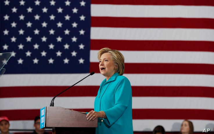 FILE - In this Aug. 25, 2016 file photo, Democratic presidential candidate Hillary Clinton speaks at a campaign in Reno, Nev. Young Hispanics, Asian-Americans and African-Americans are much more likely to trust Hillary Clinton than Donald Trump to de...