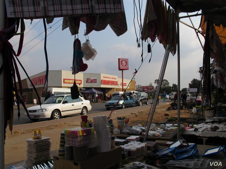 Tuck shops or Spazas have become a feature of the landscape in Dube Village, Soweto, South Africa. (Photo Gillian Parker for VOA)