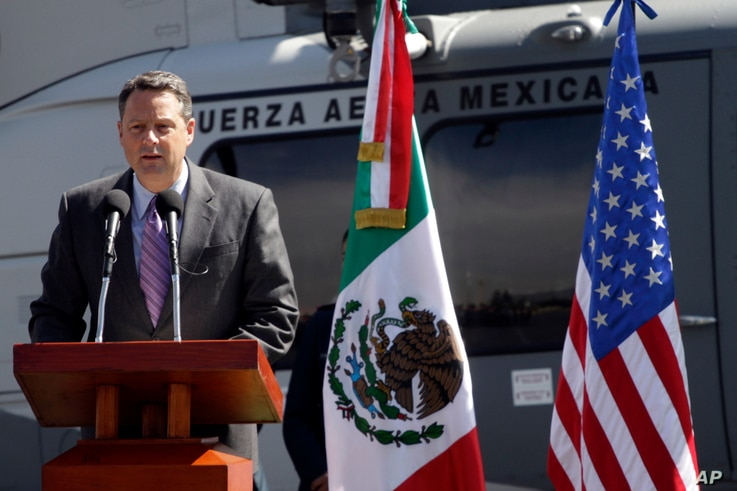 John Feeley, Deputy Chief of Mission of the US Embassy in Mexico, speaks during the delivery ceremony to the Mexican Air Force of two US made Bell-412 helicopters in Mexico City, Monday Nov. 8, 2010. The two aircrafts were added to a fleet of eight u...