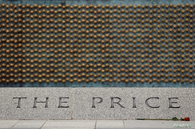 FILE - A portion of the 4,048 gold stars of the Price of Freedom wall is seen at the National World War II Memorial in Washington, June 5, 2014.