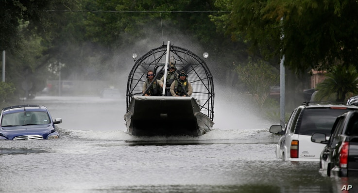 A U.S. Border Patrol air boat moves through neighborhood inundated by floodwaters from Tropical Storm Harvey in Houston, Texas, Aug. 30, 2017. John Morris, the Border Patrol's chief of staff in South Texas, said the agency had 35 boats in the cityâ...