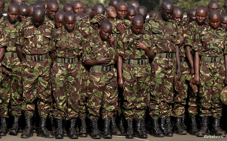 FILE - Members of the Kenya Defense Forces pay respects to the Kenyan soldiers serving in the African Union Mission in Somalia, who were killed during an attack, at a memorial mass at the Moi Barracks in Eldoret, Jan. 27, 2016.