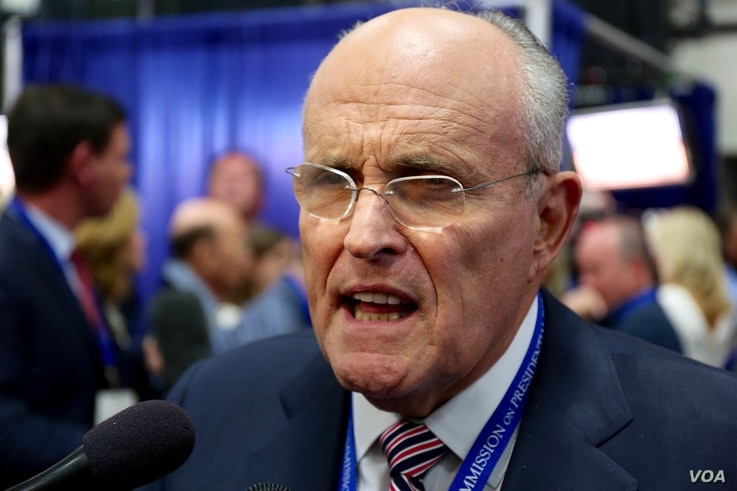 Former New York City Mayor Rudy Giuliani, a supporter of Republican presidential nominee Donald Trump, speaks to reporters after the debate, in an area known as Spin Alley, at Hofstra University in Hempstead, N.Y., Sept. 26, 2016.
