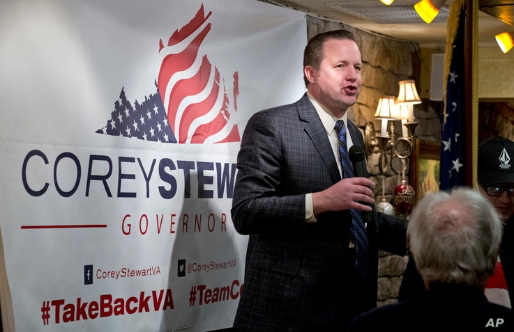 FILE - Republican candidate for governor of Virginia, Corey Stewart, speaks at a campaign kickoff rally in a restaurant in Occoquan, Va., Jan. 23, 2017. Stewart, a tough-talking former Donald Trump campaign chairman, says the president's victory ha...