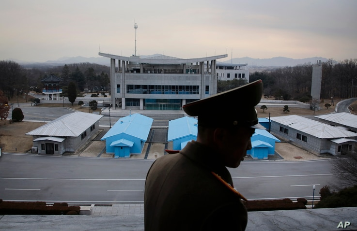 FILE - Korean People's Army Lt. Col. Nam Dong Ho is silhouetted against the truce village of Panmunjom at the Demilitarized Zone (DMZ) which separates the two Koreas, in Panmunjom, North Korea.