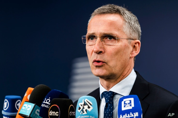 NATO Secretary-General Jens Stoltenberg talks with journalists as he arrives for a meeting of EU foreign and defense ministers at the Europa building in Brussels, May 18, 2017.