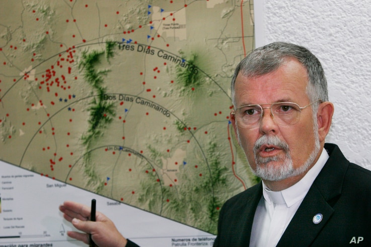 FILE - The Rev. Robin Hoover, who is president of the Humane Borders group, explains a map showing migrant deaths (red dots) on the Arizona desert and warning that crossing through the desert is extremely dangerous, during a news conference in Mexico...