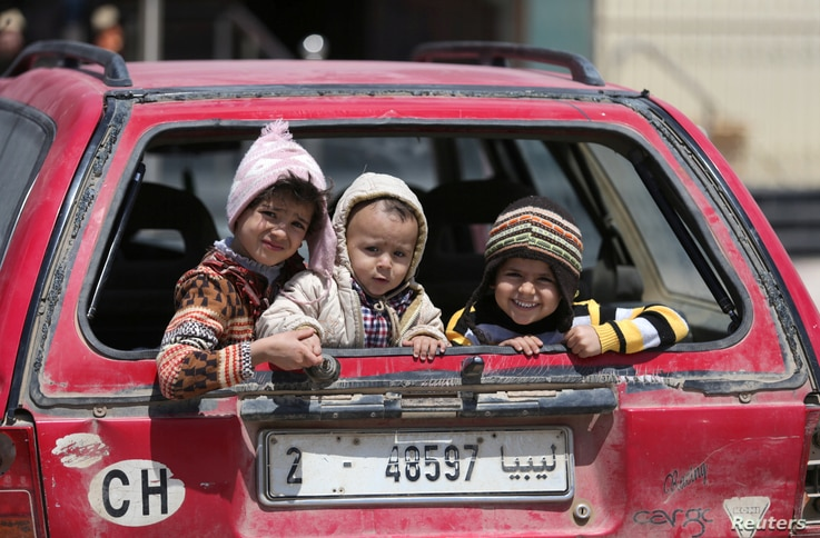 Children sit in a car in Benghazi, Libya, April 22, 2017. UNICEF says nearly 200,000 children in Libya need clean water, and more than 300,000 need educational support.