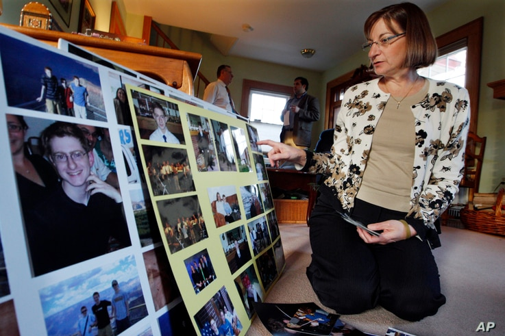 Jane Clementi, the mother of a Rutgers University student who killed himself, looks at family photographs.