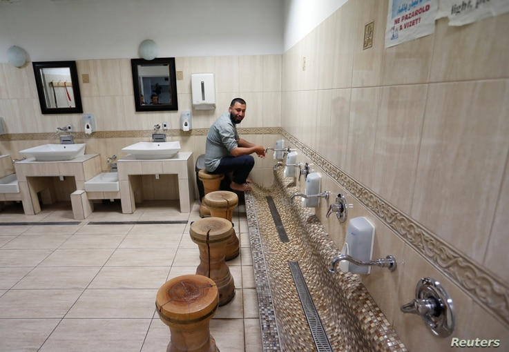 A Muslim believer washes his feet at a mosque, showing religious customs to a group of Hungarians who visited the mosque as part of an organized tour to see Budapest's Muslim community, Budapest, Hungary, Nov. 3, 2017.