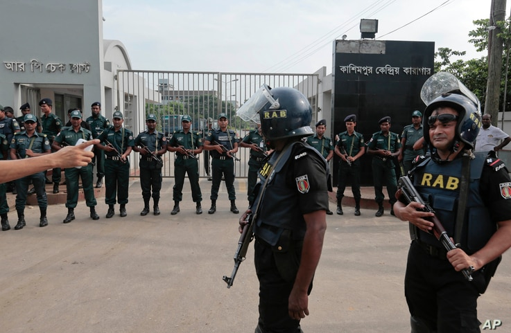 Bangladeshi security personnel stand guard in front of Kashimpur Central Jail, where Mir Quasem Ali, a senior leader of the main Islamist party Jamaat-e-Islami, was being held, in Gazipur, on the outskirts of Dhaka, Bangladesh, Sept. 3, 2016.