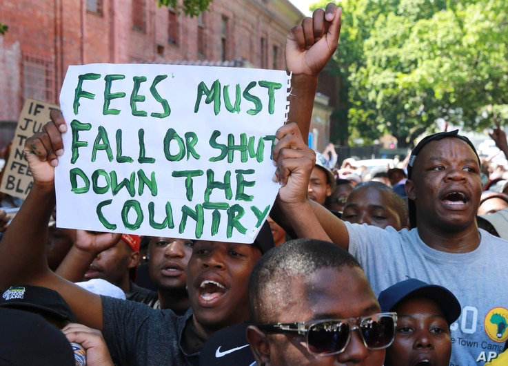 Students protesting university fee hikes are seen at a rally in Cape Town, South Africa, Oct. 22, 2015.