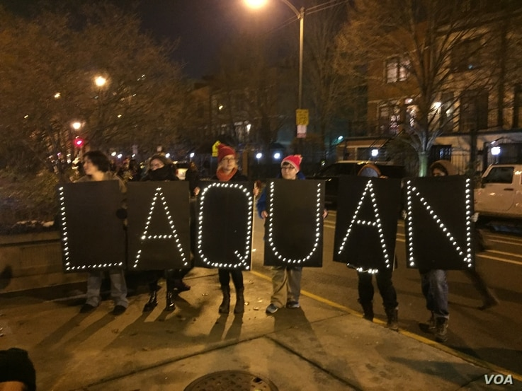 Protesters spell out the name of Laquan McDonald, who was shot in a video recently released by police. (C. Presutti/VOA)