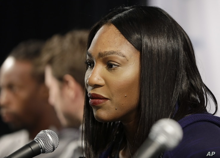 """Tennis great Serena Williams talks to reporters at a news conference in New York, March 8, 2016. Williams says fellow tennis pro Maria Sharapova """"showed a lot of courage"""" in taking responsibility for her failed drug test."""