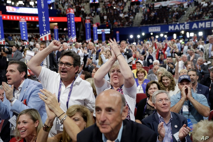 Delegates react as some call for a roll call vote on the adoption of the rules during first day of the Republican National Convention in Cleveland, July 18, 2016.