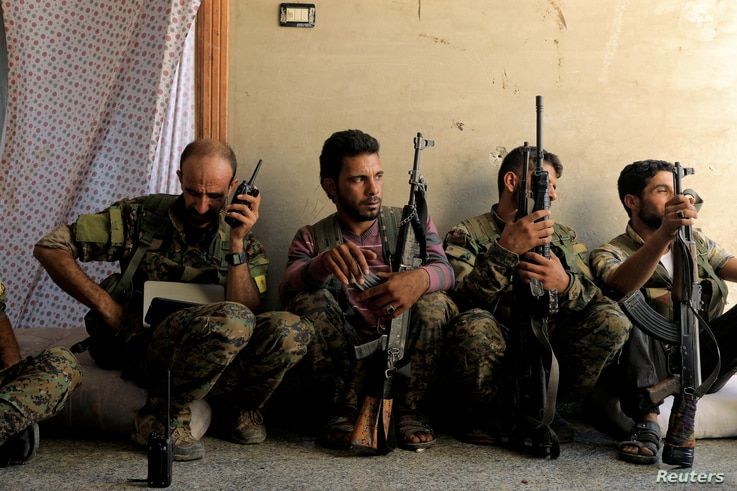 Members of the Syrian Democratic Forces keep guard at their advanced position during fighting with Islamic State militants in Nazlat Shahada, a district of Raqqa, Syria, Aug. 16, 2017.