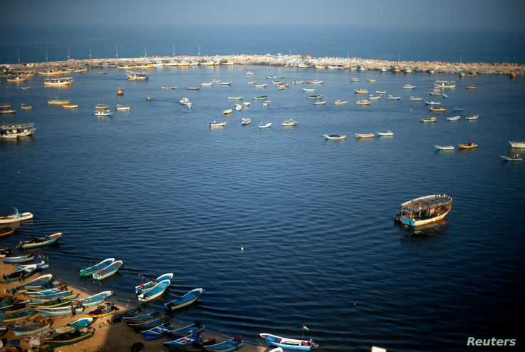 Fishing boats float at the Seaport of Gaza City, April 4, 2016. On April 3, 2016, Israel extended the distance it permits Gaza fishermen to head out to sea along certain parts of the coastline of the enclave, which is run by the Islamist group Hamas....