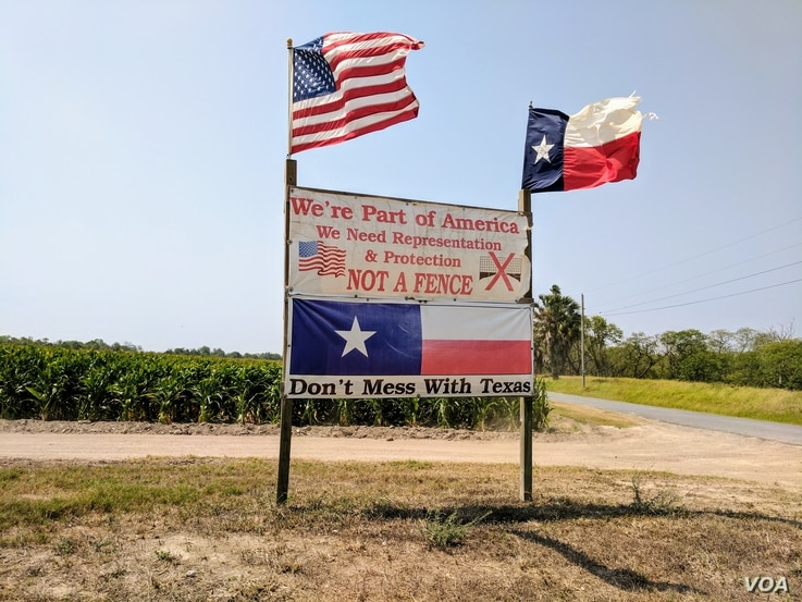 Brownsville, Texas resident Pamela Taylor erected a sign outside her property in protest of the 2006 Secure Fence Act.  Although she voted for President Trump in 2016, her philosophy on his plans to build a continuous wall remain unchanged. (R. Taylo...