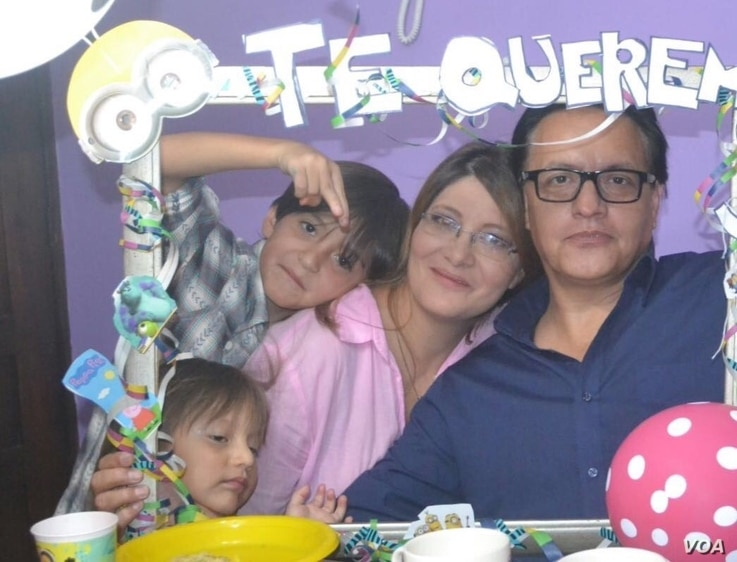Fernando Villavicencio and Veronica Sárauz pose with two of their three children in happier times, shown in a photo provided by Sárauz.