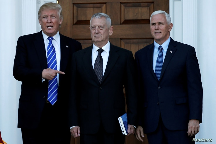 U.S. President-elect Donald Trump (L) and Vice President-elect Mike Pence (R) greet retired Marine General James Mattis in Bedminster, New Jersey, U.S., Nov. 19, 2016.