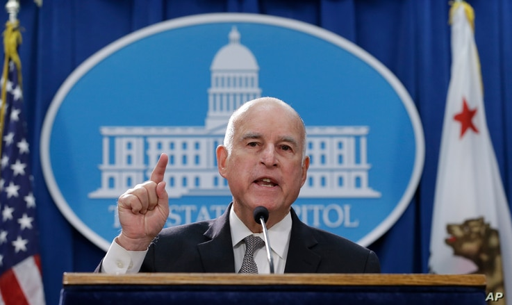 Gov. Jerry Brown discusses a lawsuit filed by 17 states and the District of Columbia over the Trump administration's plans to scrap vehicle emission standards during a news conference, May 1, 2018, in Sacramento, Calif.