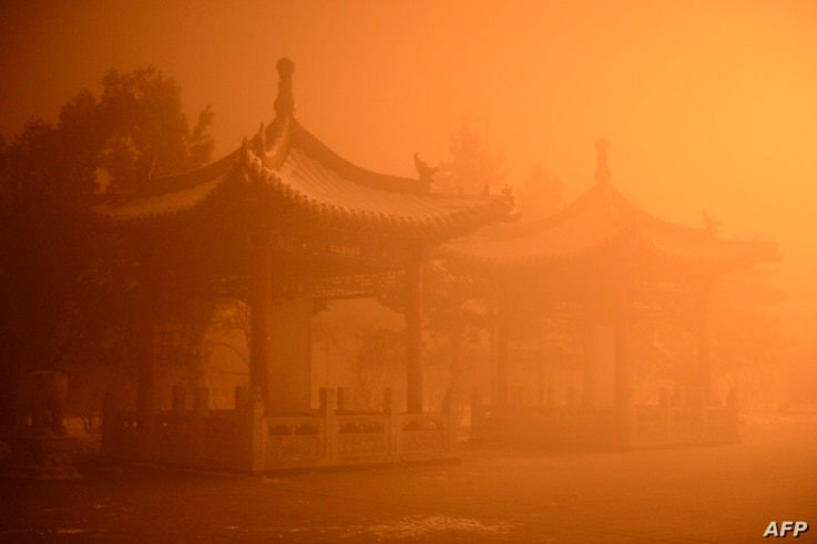 Pagodas are seen on a polluted day in Hohhot, north China's Inner Mongolia region. Northern China choked under some of the worst smog this year on Nov. 30, with Beijing's pollution soaring to 22 times healthy limits. Photo taken Nov. 29, 2015.