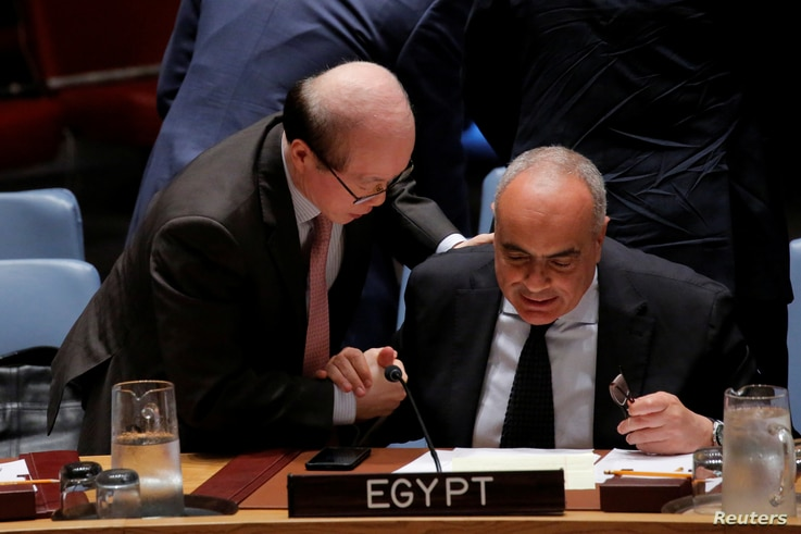 Chinese representative Liu Jieyi speaks with Egypt Ambassador Amr  Aboulatta, right, after a vote by the Security Council at the United Nations, July 29, 2016.