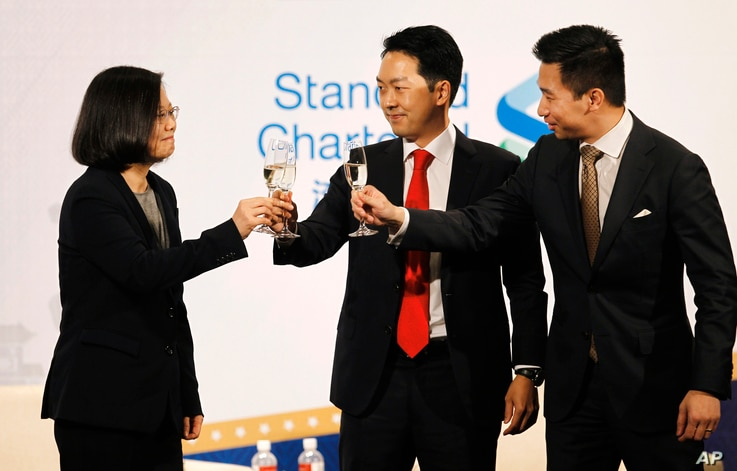 Taiwan's President Tsai Ing-wen, from left, Albert Chang, AmCham Chairman, and Alex Wong, deputy assistant secretary at the Bureau of East Asian and Pacific Affairs, U.S. Department of State, toast during the 2018 Hsieh Nien Fan of the American Cham...