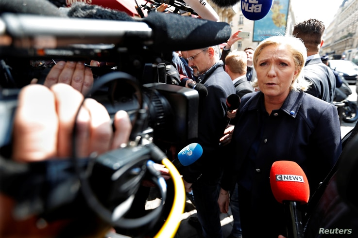 Marine Le Pen, French National Front political party leader and candidate for French 2017 presidential election, arrives at her campaign headquarters in Paris, April 28, 2017.