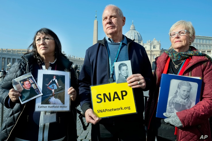 Survivors Network of those Abused by Priests (SNAP) President Tim Lennon from Tucson, Ariz., center, and SNAP members Esther Hatfield Miller from Los Angeles, left, and Carol Midboe from Austin, speak to the media in St. Peter's Square, Feb. 20, 2019...