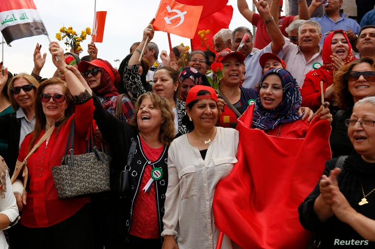 Supporters of the Iraqi Communist Party chant slogans during an International Worker's Day, or Labour Day, rally in Baghdad, May 1, 2014.