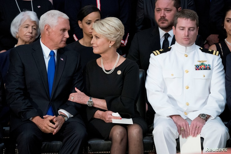Cindy McCain, wife of, Sen. John McCain, R-Ariz., right, talks with Vice President Mike Pence, left, after he speaks at a ceremony for John McCain as he lies in state in the Rotunda of the U.S. Capitol, Aug. 31, 2018, in Washington.