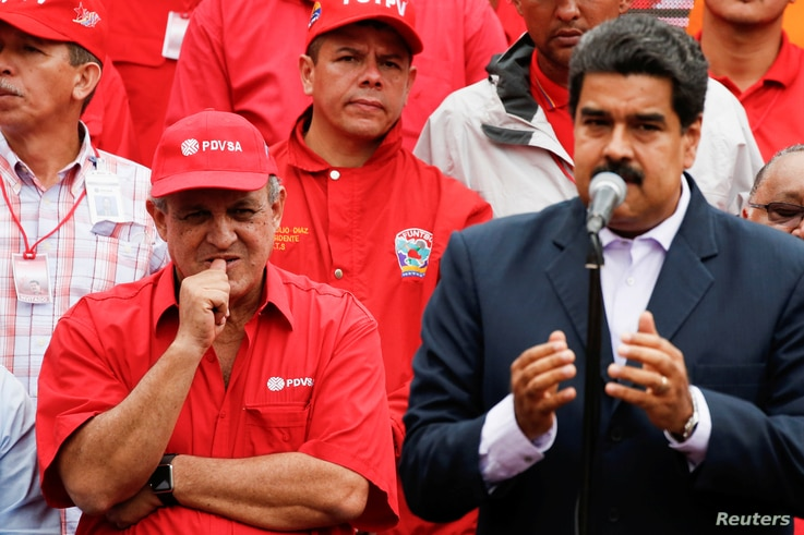 FILE -- Venezuela's Oil Minister and President of the Venezuelan state oil company PDVSA, Eulogio del Pino stands next to Venezuela's President Nicolas Maduro during a pro-government rally with workers of state-run oil company PDVSA in Caracas, Venez