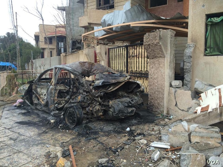 Omar, a 31-year-old electrical engineer, says militants burned his and other people's cars to protect themselves from coalition airstrikes in Mosul, Iraq, March 2, 2017. (H. Murdock/VOA)