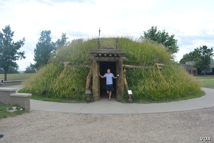 Mikah in a reconstruction of an earthlodge at the Knife River Indian Villages National Historic site, North Dakota.