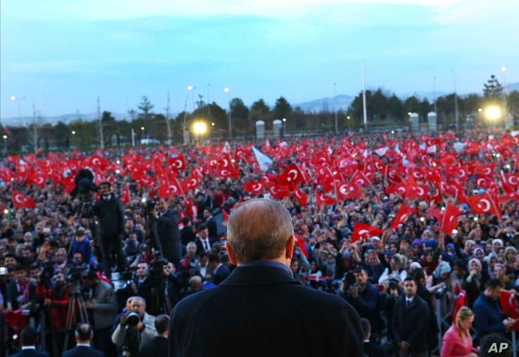 Turkey's President Recep Tayyip Erdogan delivers a speech during a rally a day after the referendum, outside the Presidential Palace, in Ankara, Turkey, Monday, April 17, 2017