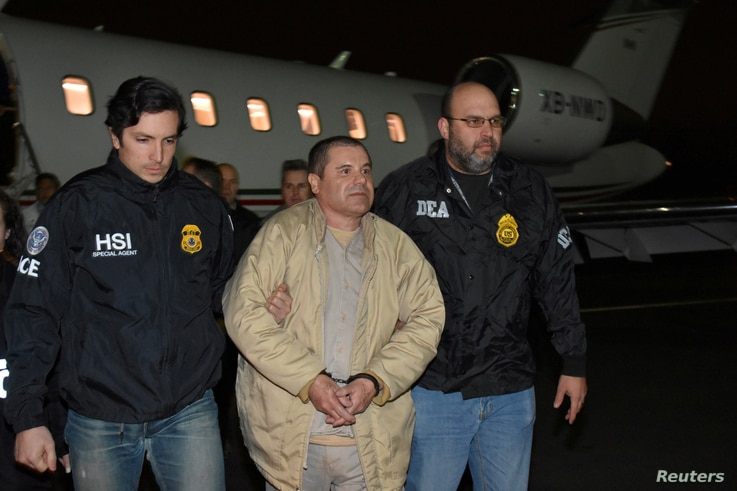Mexico's top drug lord Joaquin 'El Chapo' Guzman is escorted as he arrives at Long Island MacArthur airport in New York, U.S., Jan. 19, 2017, after his extradition from Mexico.