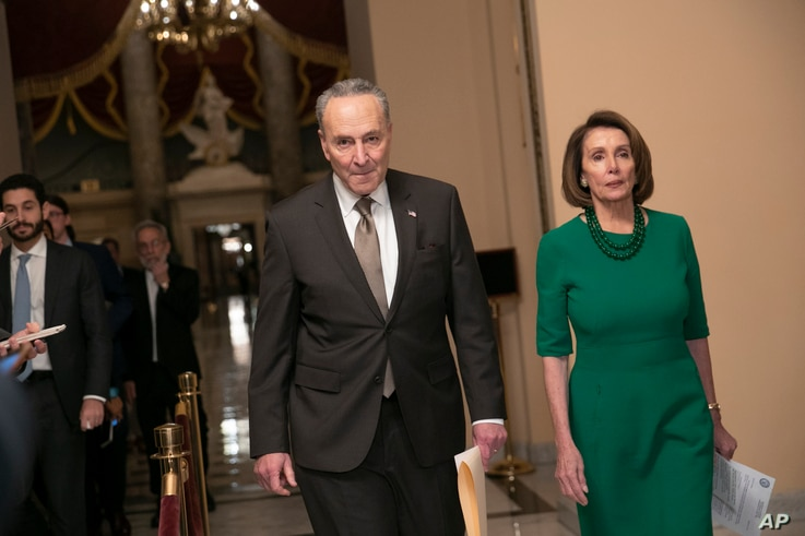 FILE - Senate Minority Leader Chuck Schumer, D-N.Y., and House Democratic Leader Nancy Pelosi of California, the speaker-designate for the new Congress, arrive to talk to reporters at the Capitol in Washington, D.C.