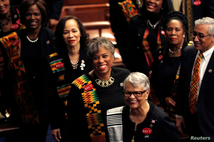 Democratic female members of Congress, wearing black to support the #MeToo movement and buttons referring to 1944 rape victim Recy Taylor, arrive on the House floor to watch U.S. President Donald Trump deliver his State of the Union address to a join...