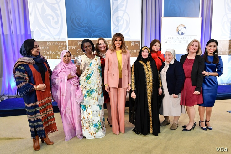 The recipients of the 2018 International Women of Courage awards gather for a group photo with first lady Melania Trump, March 23, 2018, at the State Department in Washington. From left are Roya Sadat, of Afghanistan, L'Malouma Said, of Mauritania, G...
